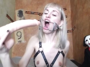 super deepthroat gagging camwhore with spider gag harness fucks her mouth