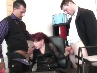 Business lady takes two cocks