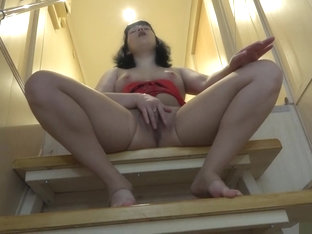 With a hairy pussy and a nylon pantyhose brunette masturbates