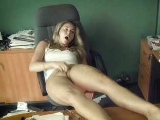 Horny secretary masturbates in the office