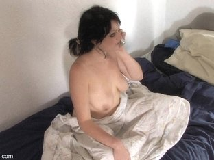 Topless down blouse video of a busty brunette on the phone