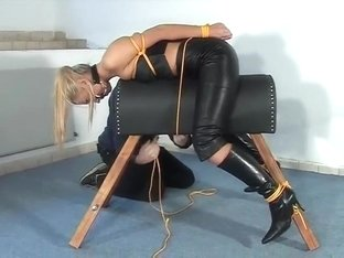Leather lady tied to the leather horse