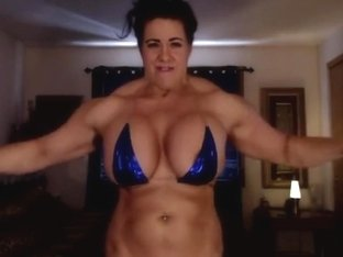 muscle woman with big fake boobs