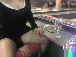 Exhibitionist fingers cunt in bar