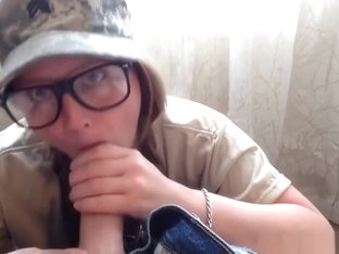 Teen hottie blows a big dick wearing an army cap