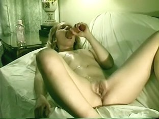 Innocent young amateur pleasures herself with a massive dildo
