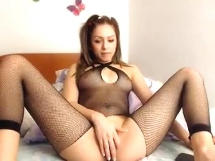 Fascinating camgirl in a fishnet bodysuit reveals her perfe