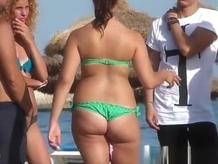 Girl in green bikini with sexy ass