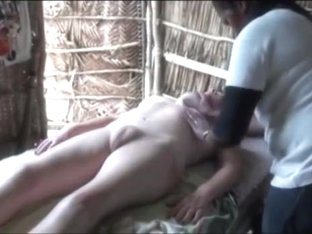 Naked white lady gets massage from black girl