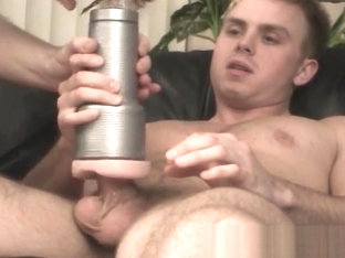Muscular young gay impales fleshlight with dick after BJ