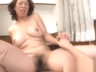 Cute Asian MILF rides a hard meat pole